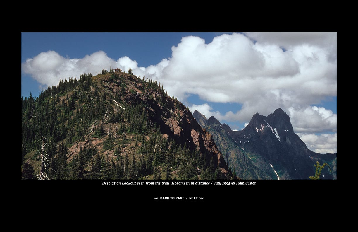 Desolation Lookout seen from the trail, Hozomeen in distance / July 1995 © John Suiter
